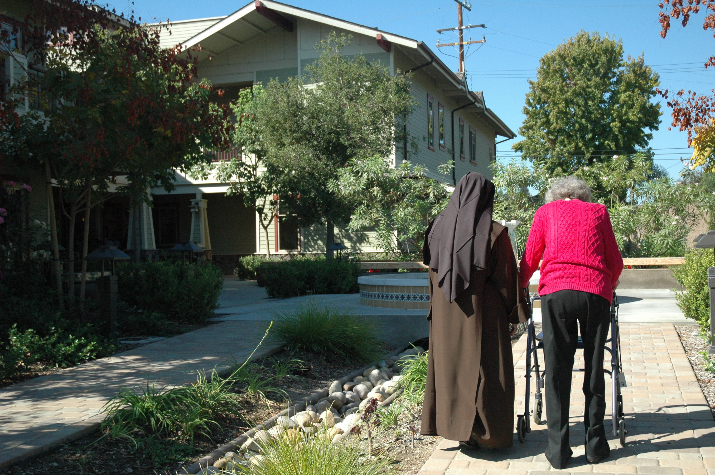 Sister Walking With Resident